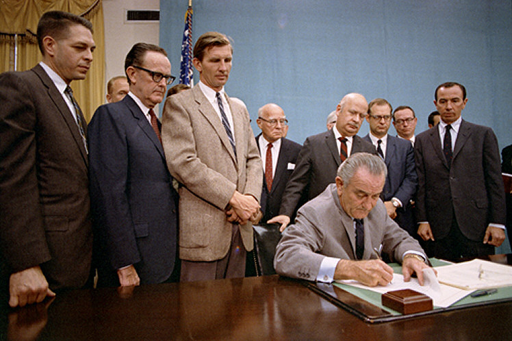 LBJ signs the Gun Control Act of 1968